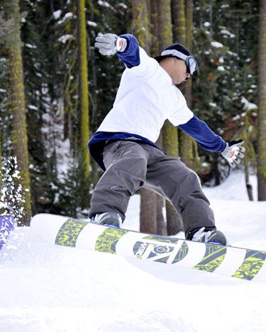 Elliott, a visiting snowboarder, performs a 360 manuever Feb. 28 while speeding down a run at Sierra-at-Tahoe. photo by Jana Hendler
