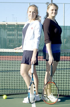 City College tennis duo Yana Buryak and Irina Yakimchuk take a moment to pose during practice Feb. 9 on the City College tennis courts. photo by Robert Paul