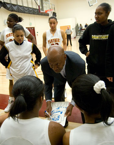 City College women's basketball coach David Carmichael gives a pep talk Feb. 10 to his team during the first quarter against San Joaquin Delta College in North Gym. photo by Robert Paul
