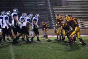 The Panther defense (right) line up against the Modesto Pirate offense during a sudden down pour of rain in the third quarter of the homecoming game. || Terri M. Venesio || venesit@imail.losrios.edu