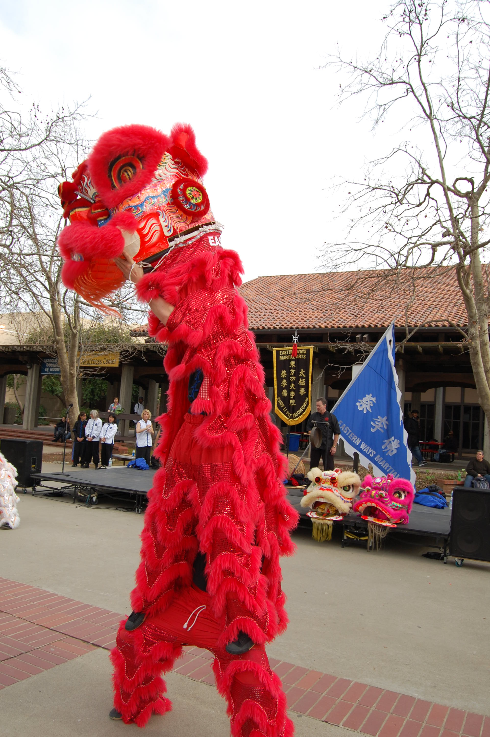 Two Lion Dancers perform a lift.