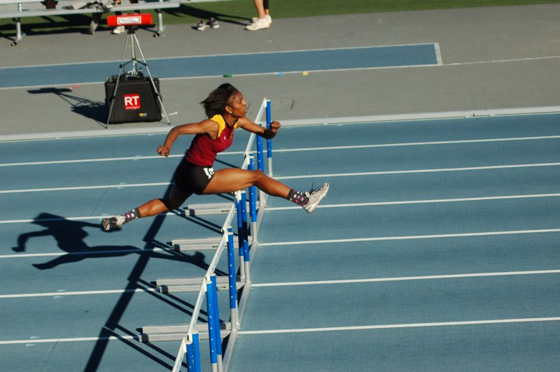 Alexandria Whitmore graces the track with her abilities in the Mini-meet at San Mateo College. Photo by Kate Paloy