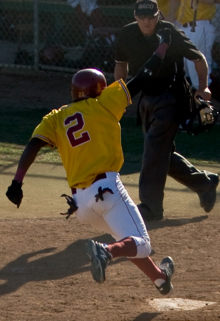 Sophomore  Davon Poole crosses home plate for the winning run in the home game against Diablo Valley College April 19, 2012.