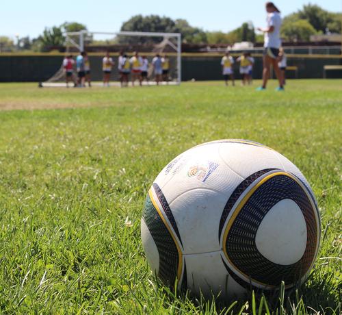 A soccer ball on a field.