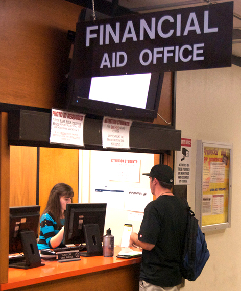 Lyubov Kuru, a clerk of two years, helps a student at the Financial Aid window located in Rodda Hall North.  Callib Carver | CallibCarver.express@gmail.com