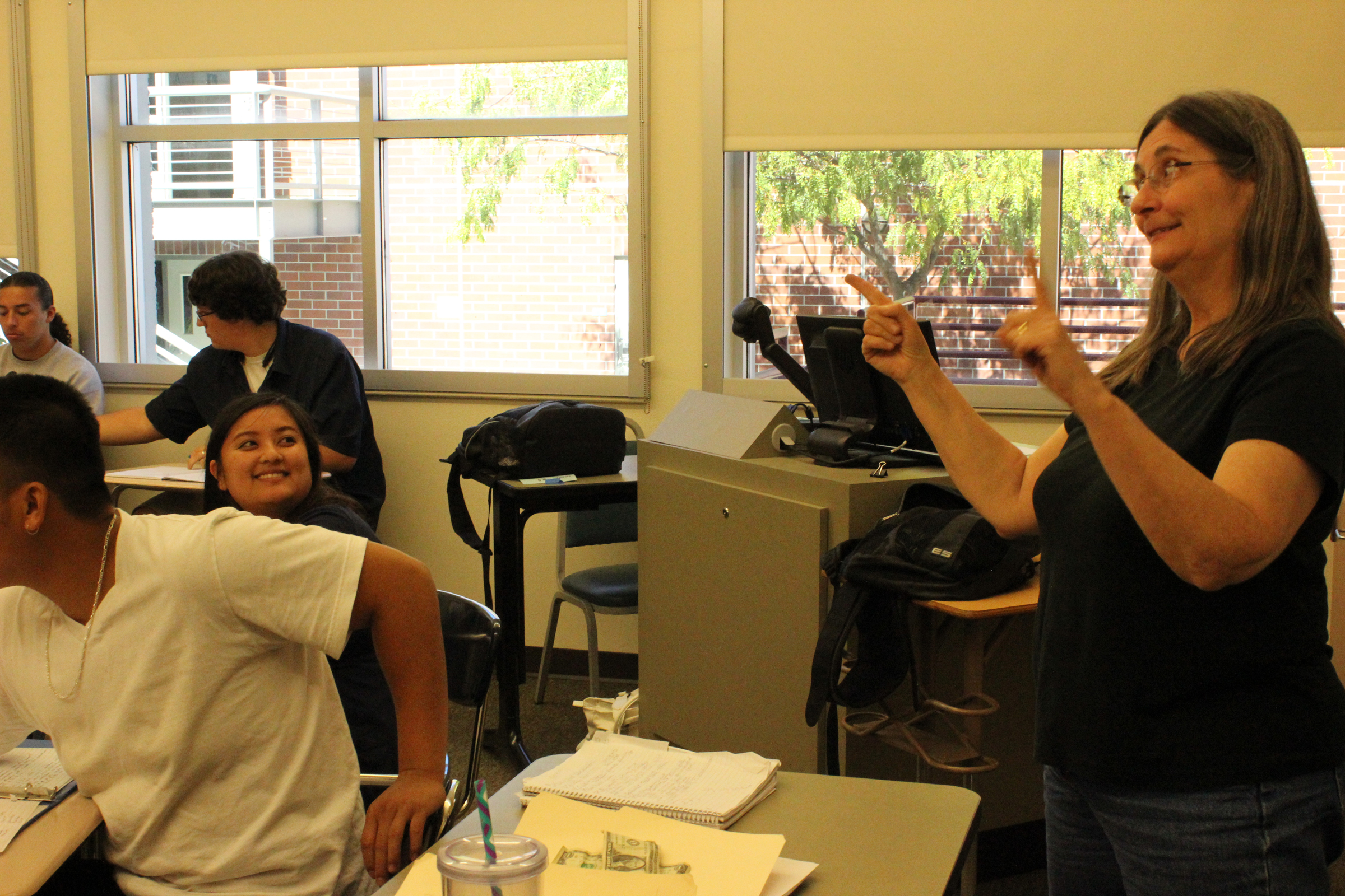 City College sign language professor, Pat Masterson, uses exaggerate facial expressions to capture attention and excite her students without sound while she teaches. Tony Wallin | dylanwaittswallin.express@gmail.com