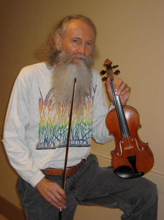 Bob Wrenn poses with  his violin  in the corridor of the Performing Arts building. Wrenn has been a music professor at City College for 11 years. Kelvin Sanders |kassr2000@gmail.com