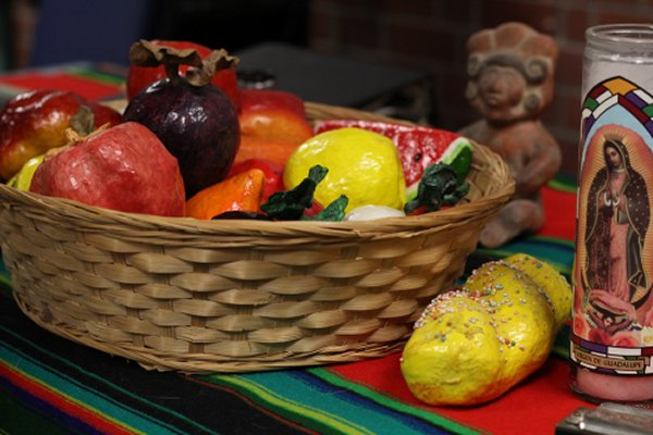PICTURE OF THE DAY-Oct. 30, 2012. Fruit, sweet bread, and candles are some of the offerings left out for the departed spirits of loved ones are part of a Dia de Los Muertos presentation inside the Cultural Awareness Center given by David Rasul, Dean of Counseling. Evan E. Duran | evaneduran@gmail.com