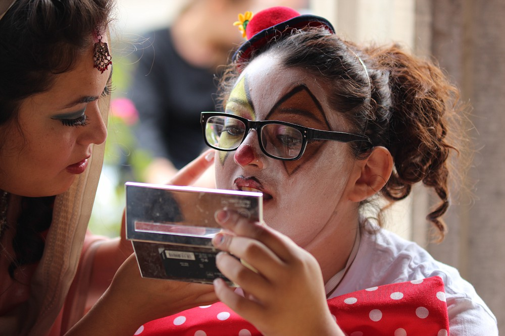 PICTURE OF THE DAY- Oct. 31, 2012.  Maria Segura, 22, cosmetology major, helps Elizabeth Alvarez, 19, Psychology major with her clown makeup during the Cosmetology Halloween Parade at City College. Kelvin Sanders|kassr2000@gmail.com