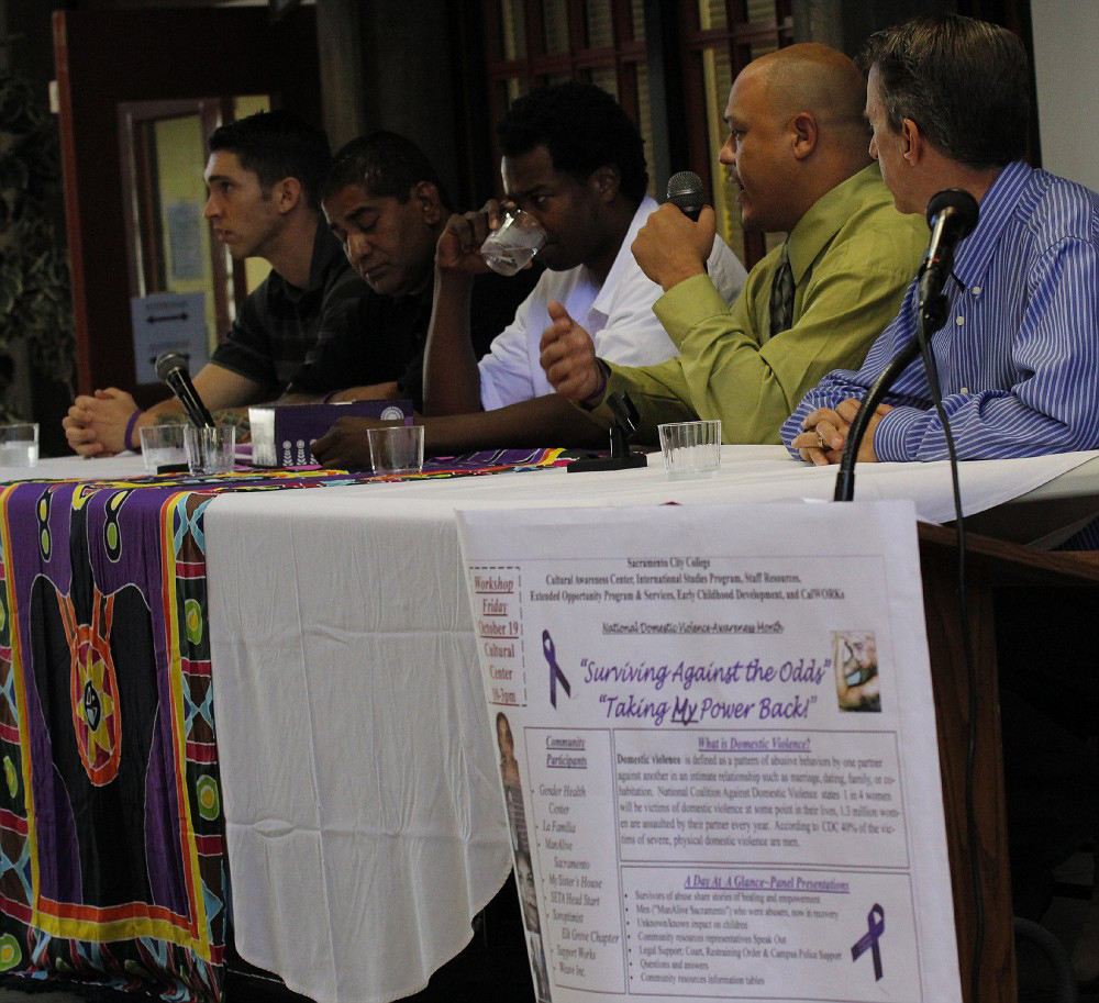 "Five men gathered to share on a panel of former domestic violence abusers as part of the ""Surviving Against All Odds"" domestic violence event on Oct. 19, 2012.  Kate Paloy 
