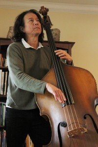 A man playing a stand-up bass.