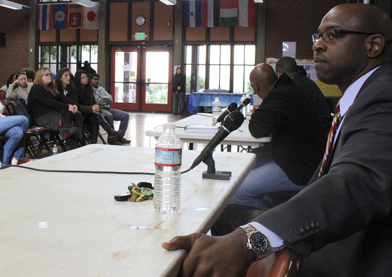 A panel of business men speak to students.