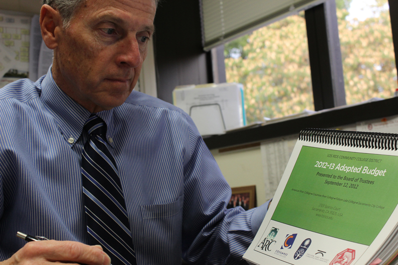 Vice President of Administrations, Robert Matinelli, holds the 2012-2013 Adopted Budget book for Los Rios Community College DIstrict.  The district had been using the X budget, (a scenario if Prop 30 failed), but with the  passing of Prop 30 it has allowed us to adopt the Y budget, which will allow the district to use $210 million in additional fundings to buy down built-up deferrals. Tony Wallin | wallintony@yahoo.com