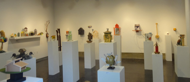 The Kondos Gallery displays a variety of styles of birdhouses by using all white columns and soft lighting. Thomas Froberg | frobergtom@yahoo.com