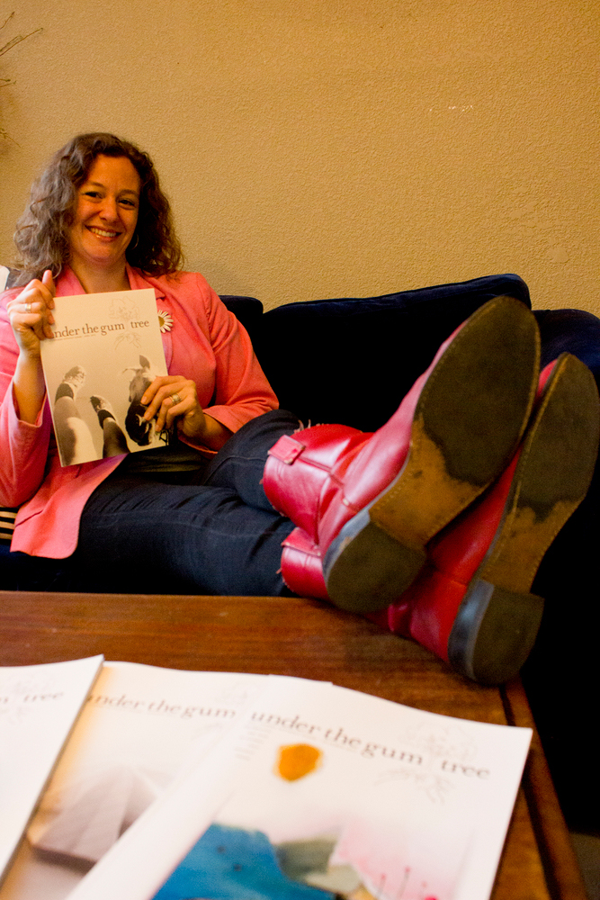 """English professor Janna Maron holds the literary magazine, """"Under the Gum Tree"""" which she is an editor of"""