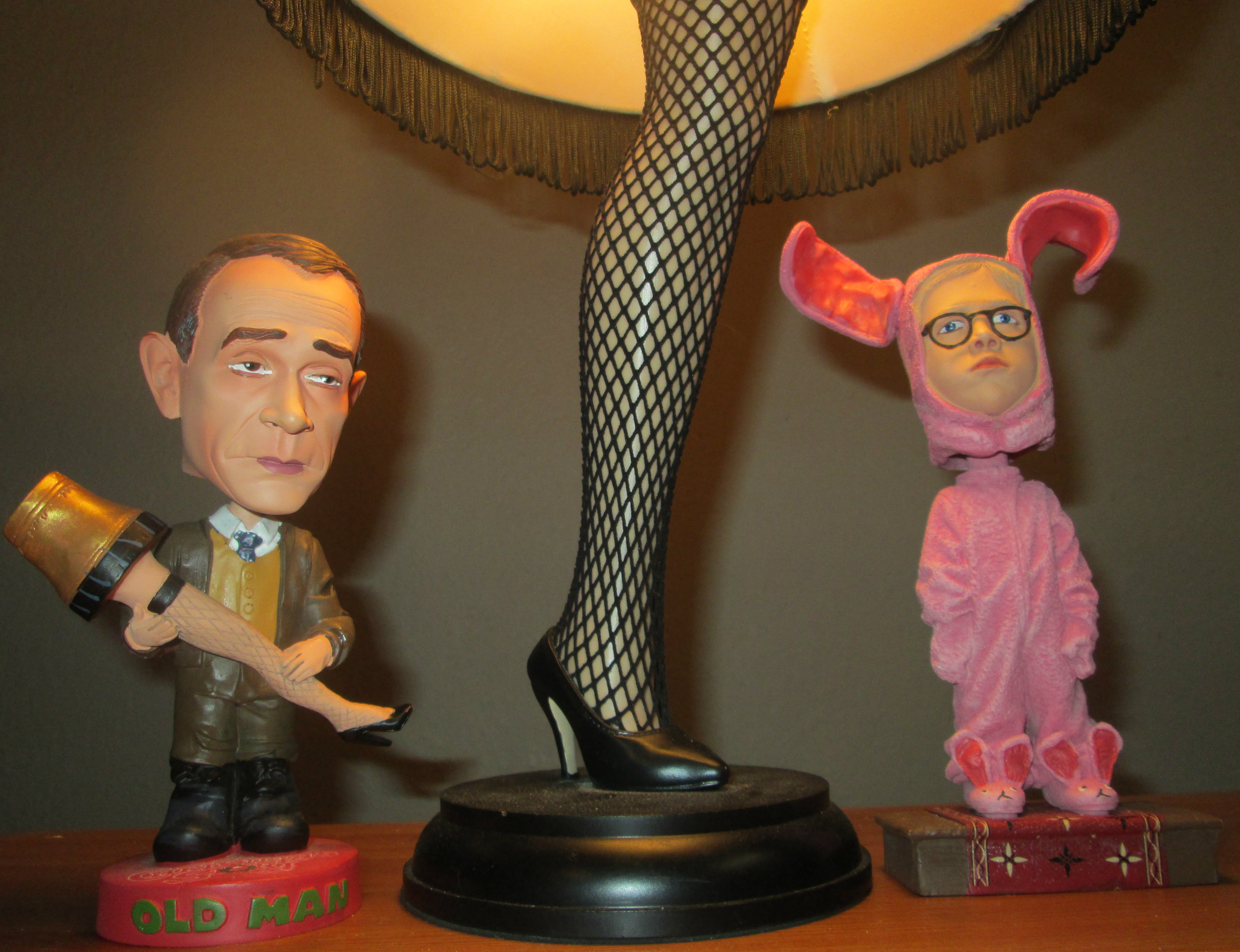 "A Christmas Story"" movie leg lamp and Bobbleheads of the movie's characters ""The Old Man"",  played by Darren McGavin and ""Ralphie"", played by Peter Billingsley sit side by side. Daniel Wilson 