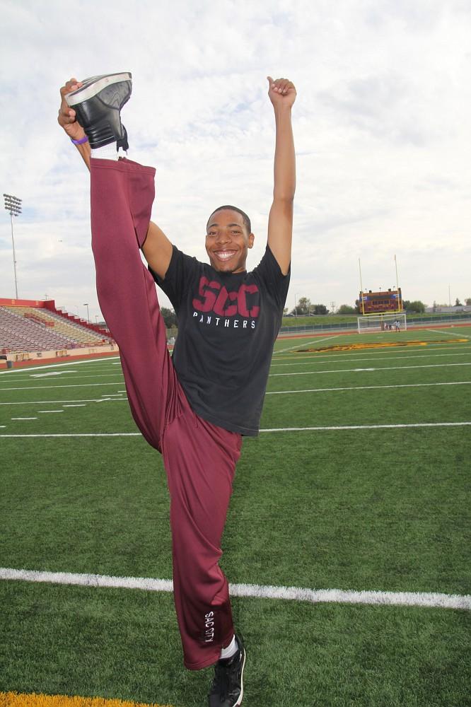 Cheerleader Marquise Ross performs a heel stretch on the football field. J.D. Villanueva | villanuevaexpress@gmail.com