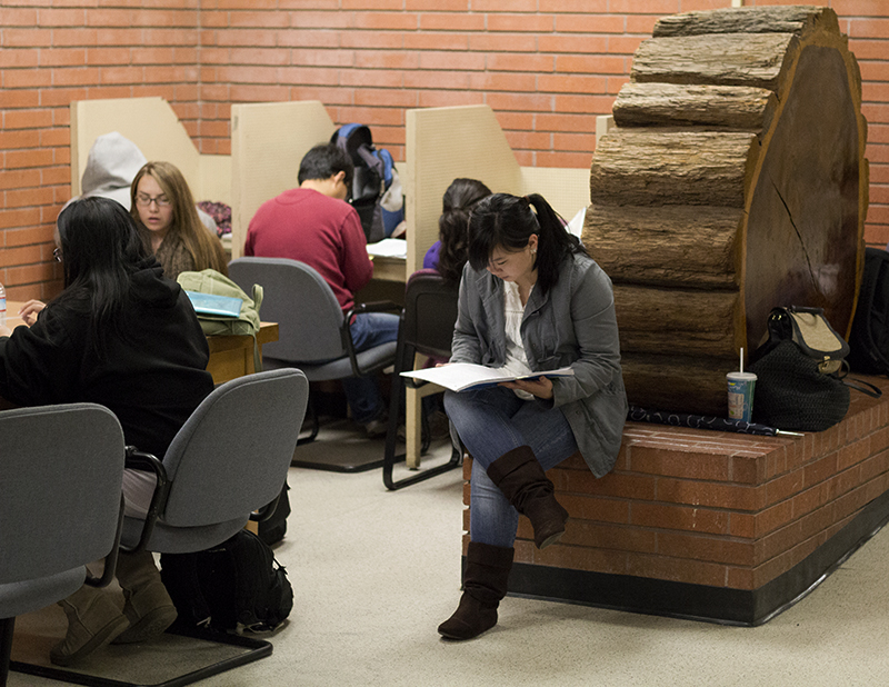 A group of students study in the hallways of Mohr Hall.