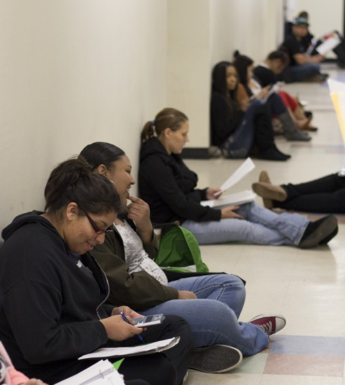 Students wait in the hallways before taking finals.
