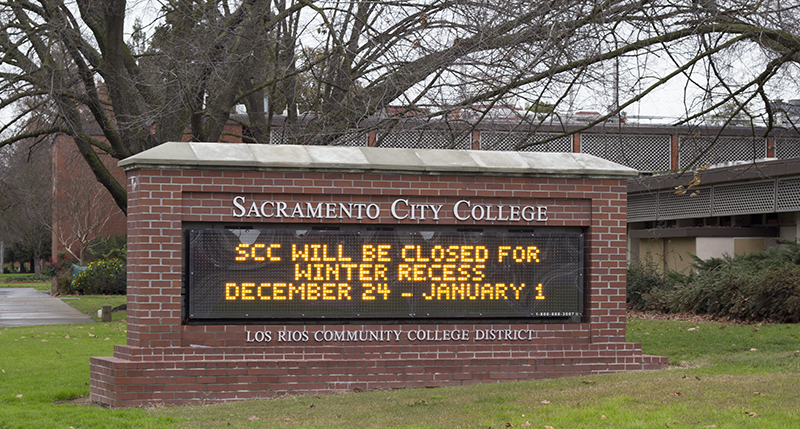 A digital sign at Sacramento City College that reads SCC will be closed for winter recess December 24 through January 1.