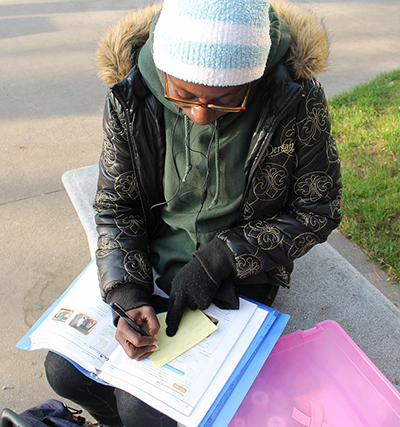 Dawn Brooks, undecided major, finishes her Spanish homework in the quad. | Harold Williams | dtectivedan2@yahoo.com