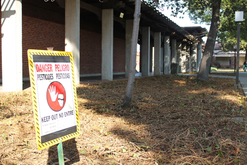 A sign posted in front of Rodda North informs passers-by of hazardous pesticides used on the campus shrubbery. | Harold Williams | haroldwilliams2@yahoo.com