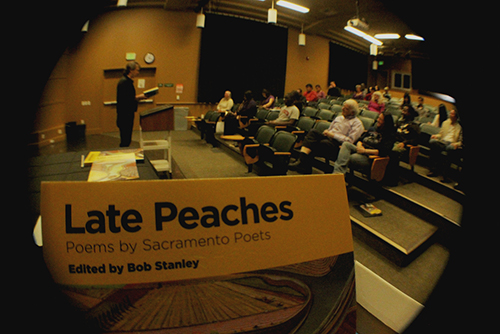 """PICTURE OF THE DAY – 2/28/13 """"Late Peaches,"""" a book of poems edited by local poet and City College professor Bob Stanley, is read by nine different Sacramento poets inside the PAC 102 theater on Thursday Feb. 28. 