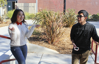 Shelly Vang discusses with her friend Oscar Rodriguez about their Valentine's Day plans outside the Art Court Theater. Vang says she is not bothered about having to work on Valentine's Day and see couples eating at the restaurant she works at. | Angelo Mabalot | acmabalot@gmail.com