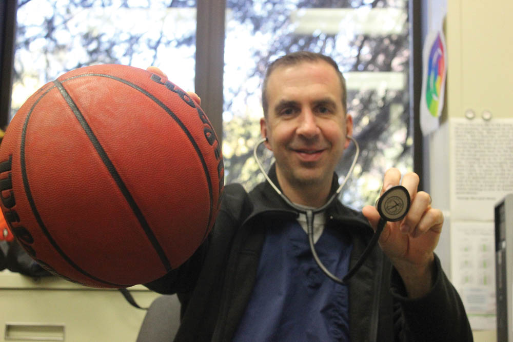 Vacaville High School  assistant coach for girls basketball team, Jeff Christian, has also been helping sick and injured students working as a nurse on campus for the past 6 years. T.William Wallin | wallintony@yahoo.com