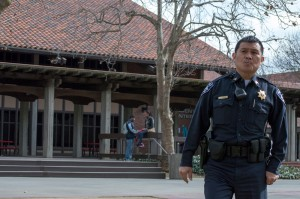 Sargeant Hien Nguyen crosses the City College quad, looking for another officer, after responding to a request to appear in the financial aid lab inside the business building. | Callib Carver | callibcarver.express@gmail.com