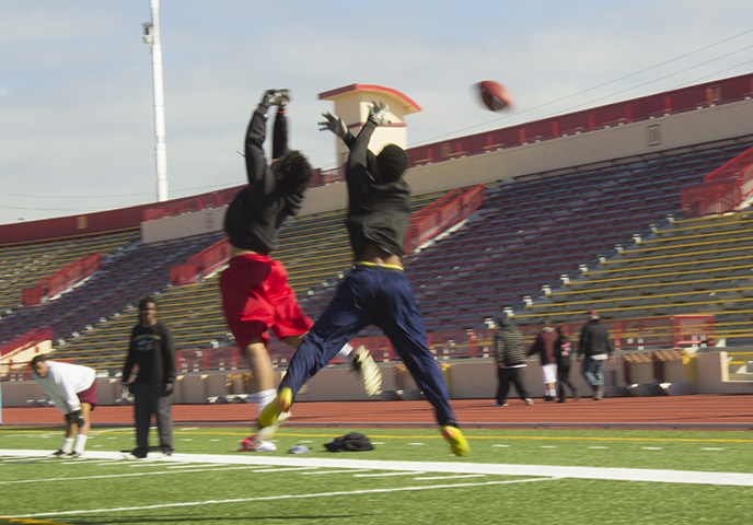 PICTURE OF THE DAY - 3/21/13 Clarence Lawrence, 18,  undeclared, misses a catch during a morning football practice session on Thursday, March 21.   Angelo Mabalot   acmabalot@gmail.com