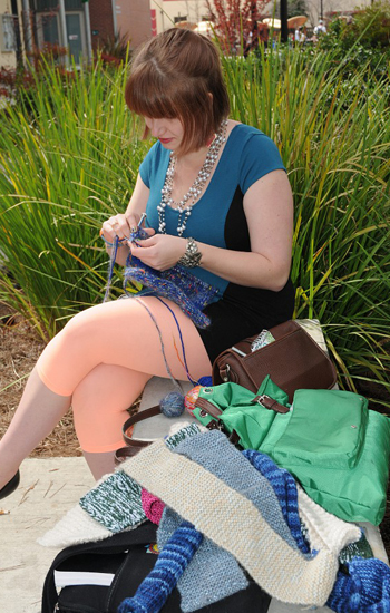 PICTURE OF THE DAY – 3/18/13 Christina Gardner, 21, art major, enjoys the great Monday weather by working on her knitting project in outside of the Fischbacher Fine Arts Building. Some of Gardner's knitted artworks hang on trees around campus.   Rafael Baez   rebaez@sbcglobal.net