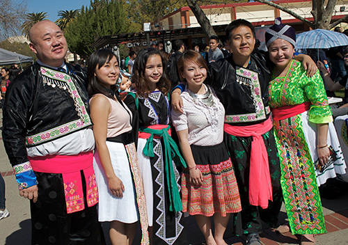 H.O.P.E. (Hmong Opportunity Program for Education) Club poses in their traditional dress during Club Day today. | A.J. Phillips | phillia7@imail.losrios.edu