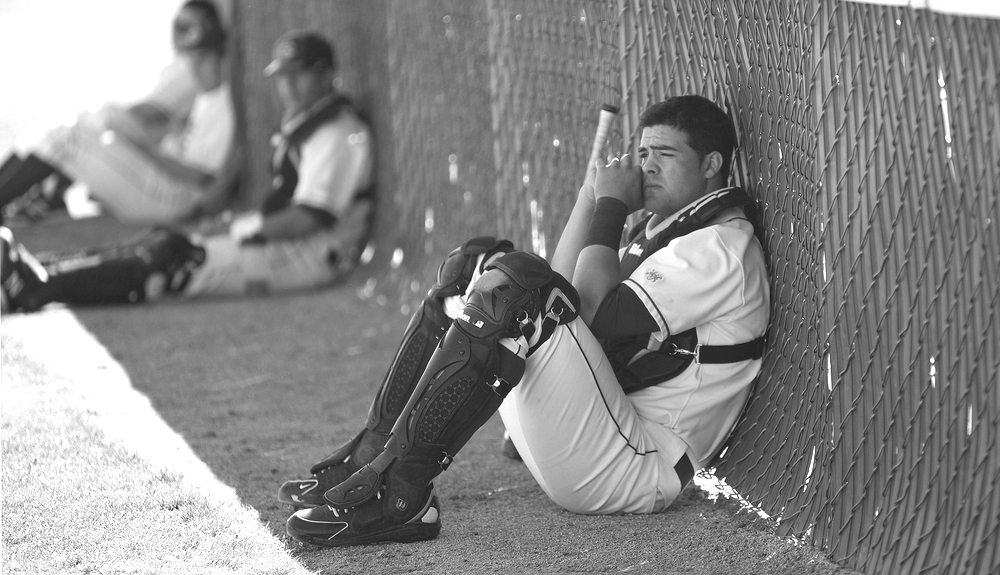 Freshman infielder/catcher Jerrod Bravo of City College takes a few minutes to meditate on the up coming game against Los Medanos College at Union Stadium Feb .26