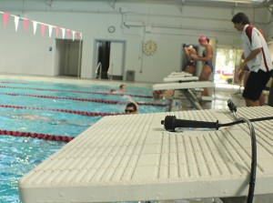 PICTURE OF THE DAY – 3/1/13 City College swim coach, Steve Hansen, connects touch pad sensors to every dive pad to record time precisely for each swimmer. American River, Santa Rosa, Los Positas, Sierra College Men and City College will all be competed against each other on the Friday, March 1 swim meet at City College. | T.William Wallin | wallintony@yahoo.com