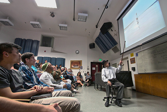 PICTURE OF THE DAY – 4/11/13 Gregory Kondos points out how much he loves his own art work during a lecture on Thursday, April 11 in PAC-113. The Kondos Gallery on campus is celebrating Kondos' 90th birthday showing his work until April 26. | A.J. Phillips | w1103744@apps.losrios.edu