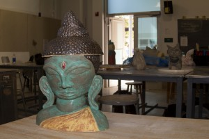 "PICTURE OF THE DAY – 4/9/13 ""Enlightenment Soup."" A ceramic Buddha Head created by Kim Richardson for ART 391: Intermediate Ceramics, located in FIA 130.  Richardson plans to serve vegetarian soup in the bowl hidden within the sculpture. 