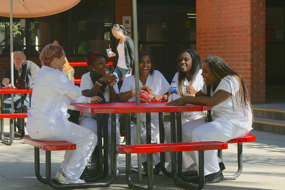 Knowing nutrition is important for healthy hair, nails, and skin, these City College cosmetology student gather for a bit to eat outside the campus City Cafe. Teri Barth // staff photographer // express.teri.barth@gmail.com
