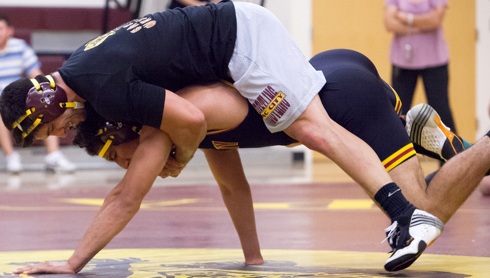 Sophomore Alex Chambers wrestles alumnus Mark Pfeifer during the City College alumni scrimmage match Sept. 13. Dianne Rose | Multimedia Editor  | dianne.rose.express@gmail.com