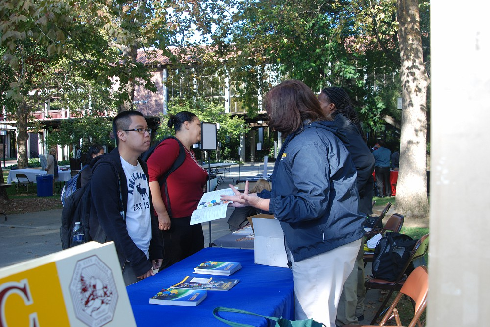 Jason Nguyen, biological science major, talking with a UC San Diego representative during Transfer Day in the City College Quad. Mahalie Oshiro | mahalie.oshiro@gmail.com