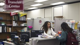 Receptionist Juliana Singleton helps a student in the Transfer Center