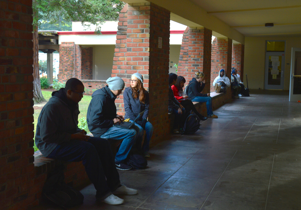 Students relax Jan. 29 on the brick the wall just outside the Preforming Arts Center. Emily Foley | Staff Photographer