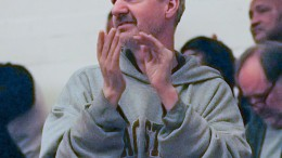 Randy Hicks applauds at a City College men's basketball game Feb. 21. Hicks has been attending games since 1998.