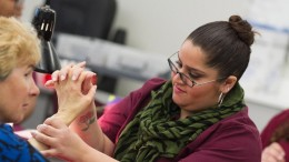 City College student nail technician Darling Demaro performs reflexology while giving a Cosmetology department client a manicure March 5. Photo by Tamara M. Knox l Online Photo Editor l tmrknox@gmail.com
