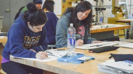 City College students Deborah Vega (left), major undecided, and communications major Nicole Graham work on a collage piece project March 26 during ART 320. Emily Foley   Staff Photographer   emmajfoley@gmail.com