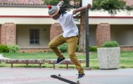 Graphic design major Malcolm Moore attempts to land his skateboard while outside the Preforming Arts Center April 2. Moore says his passion for skateboarding began in the eighth grade. Emily Foley | Staff Photographer | emmajfoley@gmail.com