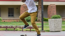 Graphic design major Malcolm Moore attempts to land his skateboard while outside the Preforming Arts Center April 2. Moore says his passion for skateboarding began in the eighth grade.   Emily Foley   Staff Photographer   emmajfoley@gmail.com