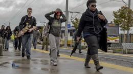Through wind and rain, City College students make their way to class April 1 from Sacramento RT's City College Station. Elizabeth Ramirez Staff Photographer  elizabethramirezexpress@gmail.com