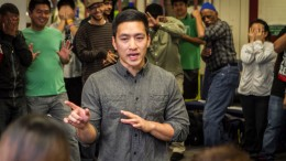 Spoken Word Artist Fong interacts with Professor Dinh Bui's class in the Cultural Awareness Center April 2 by asking them to participate in an icebreaker before his spoken word performance.  Photo by Tamara M. Knox  l Online Photo Editor l  tmrknox@gmail.com