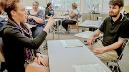 American sign language students Jenna Vanina and Richard Varela must communicate without using their voices April 8 during a SILA 305 sign language conversation quiz. Elizabeth Ramirez   Staff Photographer   elizabethramirezexpress@gmail.com